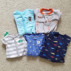Set of 5 newborn sized footie pajamas